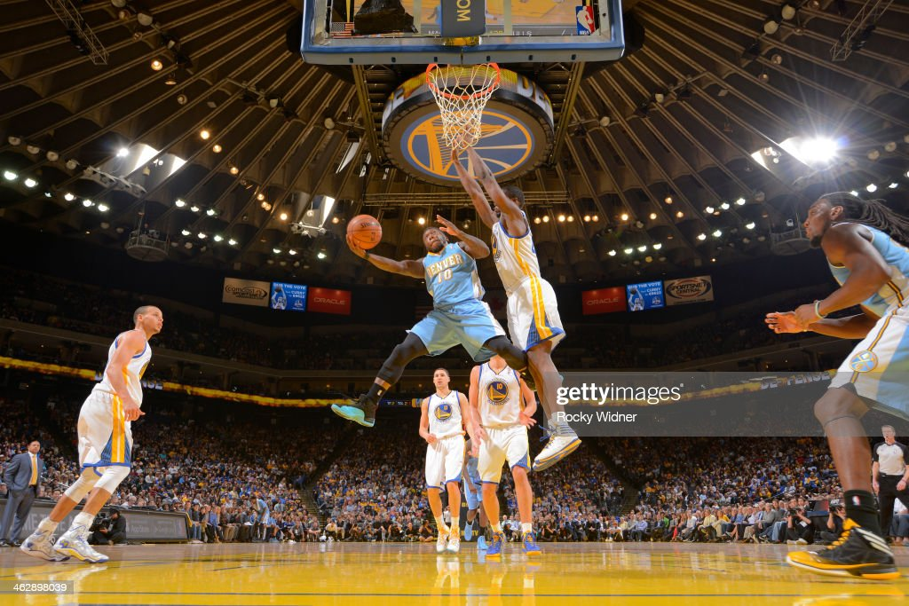 Nate Robinson #10 of the Denver Nuggets goes up for the shot against Harrison Barnes #40 of the Golden State Warriors on January 15, 2014 at Oracle Arena in Oakland, California.