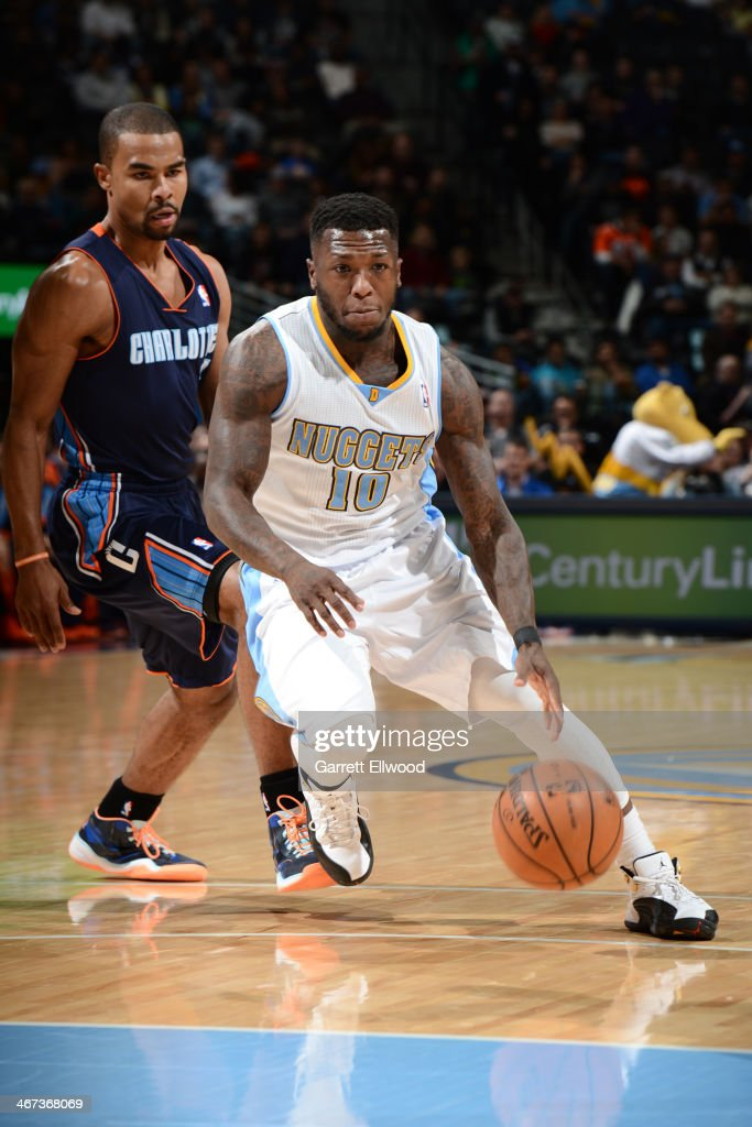 Nate Robinson #10 of the Denver Nuggets handling the ball during a game against the Charlotte Bobcats on January 29, 2014 at the Pepsi Center in Denver, Colorado.