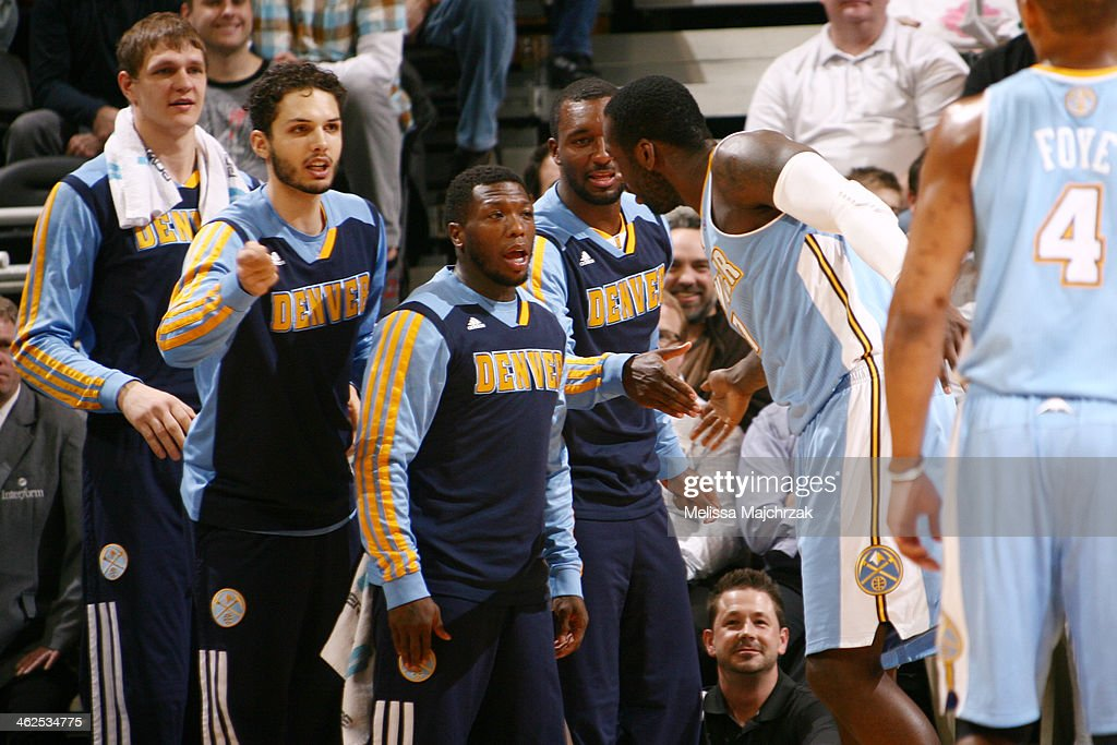 Nate Robinson #10 of the Denver Nuggets looks on against the Utah Jazz then celebrates with teammates at EnergySolutions Arena on January 13, 2014 in Salt Lake City, Utah.