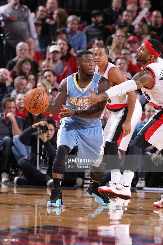 Nate Robinson #10 of the Denver Nuggets passes the ball against the Portland Trail Blazers on January 23, 2014 at the Moda Center Arena in Portland, Oregon.