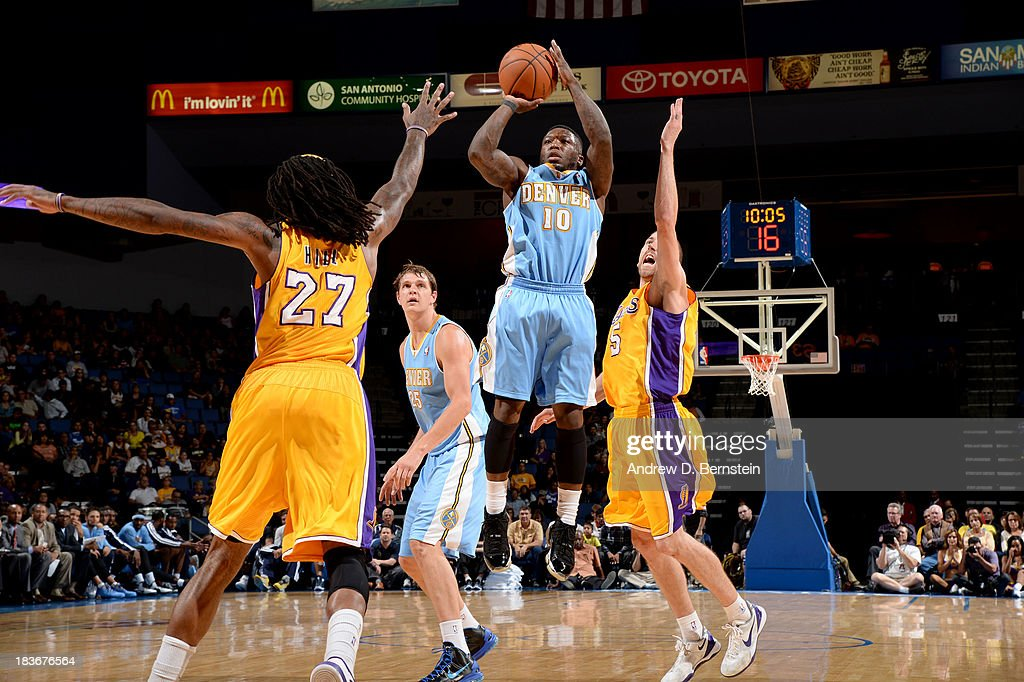 <a gi-track='captionPersonalityLinkClicked' href=/galleries/search?phrase=Nate+Robinson&family=editorial&specificpeople=208906 ng-click='$event.stopPropagation()'>Nate Robinson</a> #10 of the Denver Nuggets puts up the shot against <a gi-track='captionPersonalityLinkClicked' href=/galleries/search?phrase=Jordan+Hill+-+Basketball+Player&family=editorial&specificpeople=13503530 ng-click='$event.stopPropagation()'>Jordan Hill</a> #27 of the Los Angeles Lakers at Citizens Business Bank Arena on October 8, 2013 in Ontario, California.