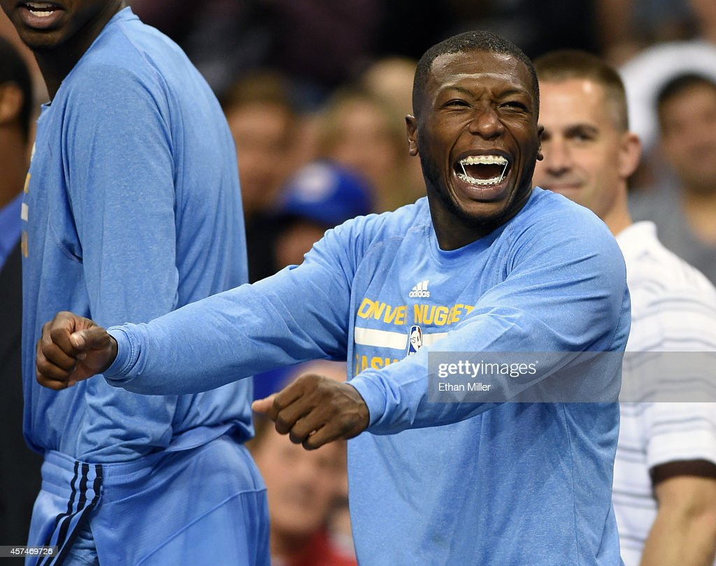 <a gi-track='captionPersonalityLinkClicked' href=/galleries/search?phrase=Nate+Robinson&family=editorial&specificpeople=208906 ng-click='$event.stopPropagation()'>Nate Robinson</a> #5 of the Denver Nuggets reacts as he watches a fan dance on the baseline during a preseason game against the Los Angeles Clippers at the Mandalay Bay Events Center on October 18, 2014 in Las Vegas, Nevada. Denver won 104-93.