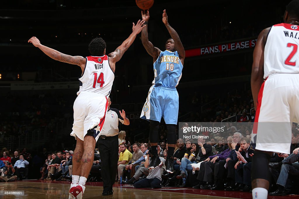 <a gi-track='captionPersonalityLinkClicked' href=/galleries/search?phrase=Nate+Robinson&family=editorial&specificpeople=208906 ng-click='$event.stopPropagation()'>Nate Robinson</a> #10 of the Denver Nuggets shoots against Glen Rice #14 of the Washington Wizards during the game at the Verizon Center on December 8, 2013 in Washington, DC.