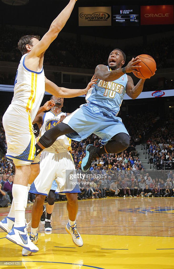 Nate Robinson #10 of the Denver Nuggets shoots against the Golden State Warriors on January 15, 2014 at Oracle Arena in Oakland, California.