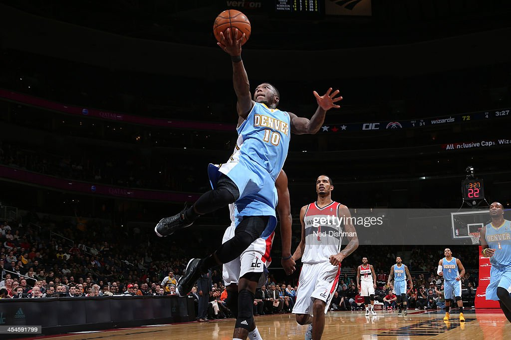 <a gi-track='captionPersonalityLinkClicked' href=/galleries/search?phrase=Nate+Robinson&family=editorial&specificpeople=208906 ng-click='$event.stopPropagation()'>Nate Robinson</a> #10 of the Denver Nuggets shoots against the Washington Wizards during the game at the Verizon Center on December 8, 2013 in Washington, DC.