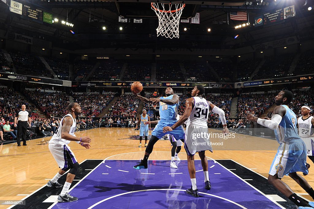 Nate Robinson #10 of the Denver Nuggets shoots the ball against Jason Thompson #34 of the Sacramento Kings at Sleep Train Arena on January 26, 2014 in Sacramento, California.