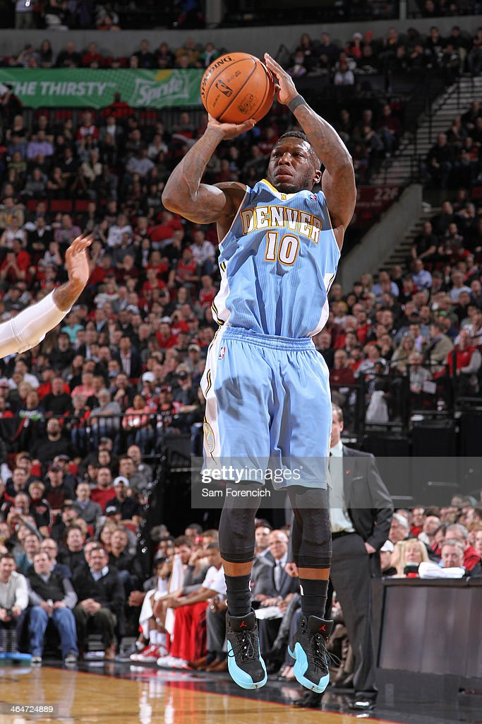 Nate Robinson #10 of the Denver Nuggets shoots the ball against the Portland Trail Blazers on January 23, 2014 at the Moda Center Arena in Portland, Oregon.