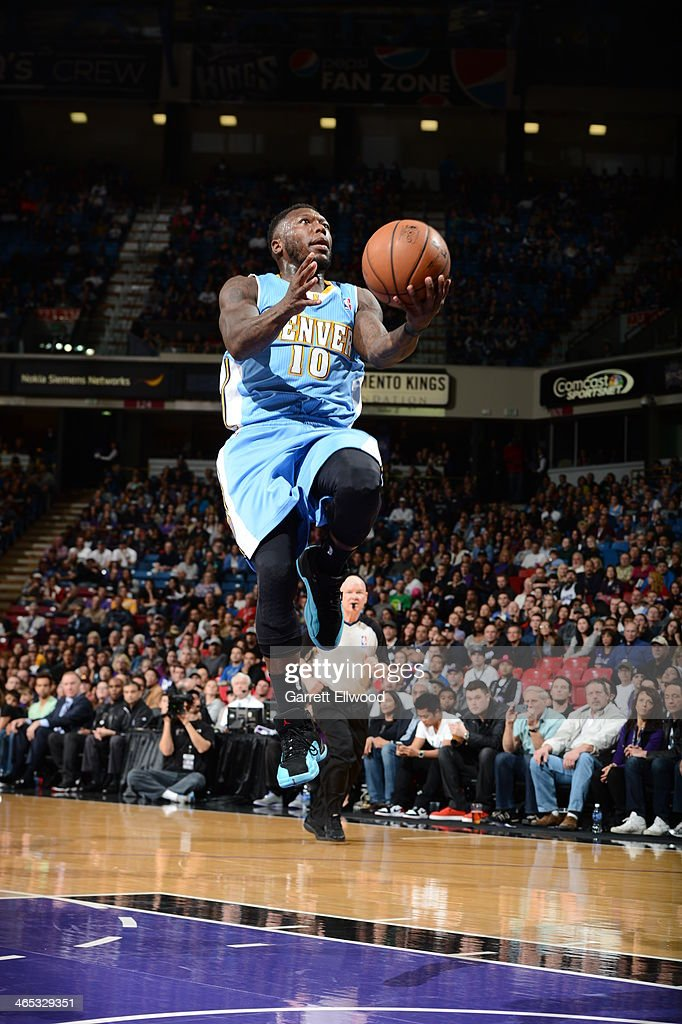 Nate Robinson #10 of the Denver Nuggets takes the ball to the basket against the Sacramento Kings at Sleep Train Arena on January 26, 2014 in Sacramento, California.