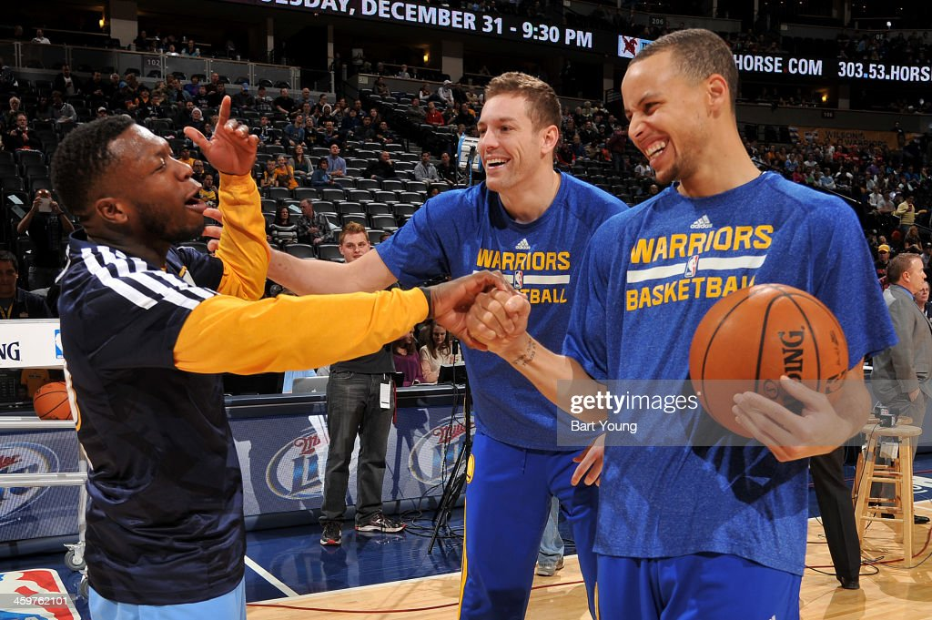 <a gi-track='captionPersonalityLinkClicked' href=/galleries/search?phrase=Nate+Robinson&family=editorial&specificpeople=208906 ng-click='$event.stopPropagation()'>Nate Robinson</a> #10 of the Denver Nuggets talks to Stephen Curry #30 and David Lee #10 of the Golden State Warriors before the game on December 23, 2013 at the Pepsi Center in Denver, Colorado.