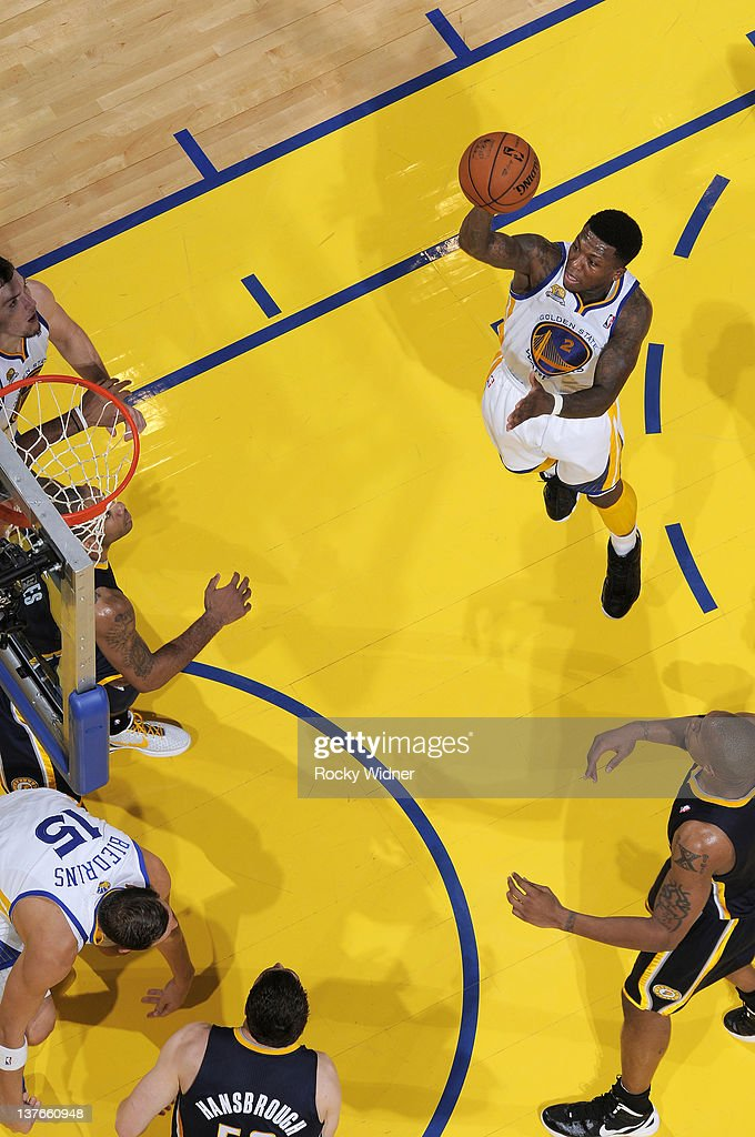 <a gi-track='captionPersonalityLinkClicked' href=/galleries/search?phrase=Nate+Robinson&family=editorial&specificpeople=208906 ng-click='$event.stopPropagation()'>Nate Robinson</a> #2 of the Golden State Warriors attempts a floater during a game against the Indiana Pacers on January 20, 2012 at Oracle Arena in Oakland, California.