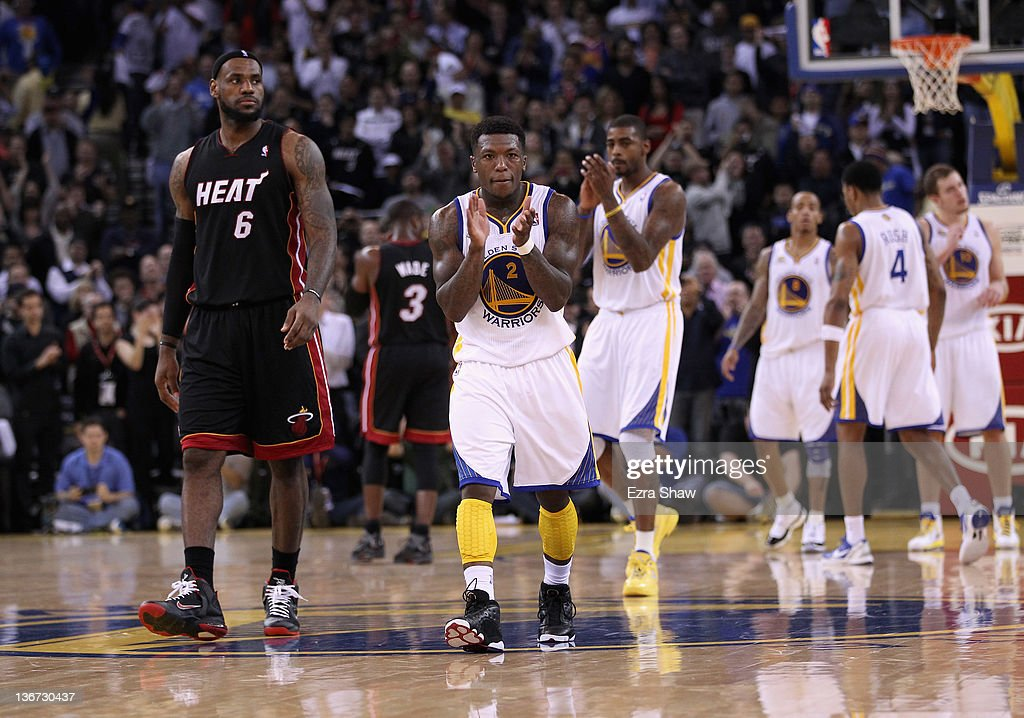 <a gi-track='captionPersonalityLinkClicked' href=/galleries/search?phrase=Nate+Robinson&family=editorial&specificpeople=208906 ng-click='$event.stopPropagation()'>Nate Robinson</a> #2 of the Golden State Warriors claps his hands in front of <a gi-track='captionPersonalityLinkClicked' href=/galleries/search?phrase=LeBron+James&family=editorial&specificpeople=201474 ng-click='$event.stopPropagation()'>LeBron James</a> #6 of the Miami Heat at Oracle Arena on January 10, 2012 in Oakland, California.