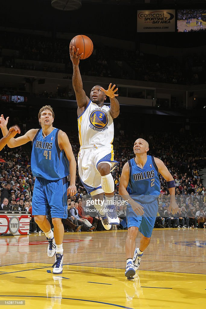 <a gi-track='captionPersonalityLinkClicked' href=/galleries/search?phrase=Nate+Robinson&family=editorial&specificpeople=208906 ng-click='$event.stopPropagation()'>Nate Robinson</a> #2 of the Golden State Warriors lays the ball up against the Dallas Mavericks on April 12, 2012 at Oracle Arena in Oakland, California.