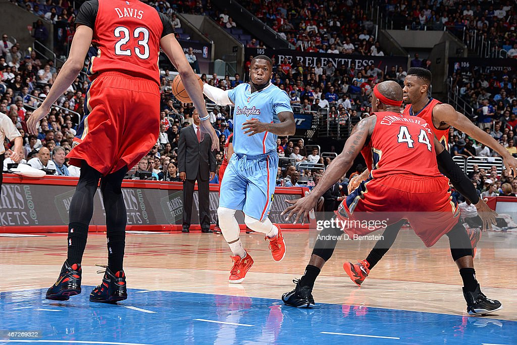 <a gi-track='captionPersonalityLinkClicked' href=/galleries/search?phrase=Nate+Robinson&family=editorial&specificpeople=208906 ng-click='$event.stopPropagation()'>Nate Robinson</a> #8 of the Los Angeles Clippers handles the ball against the New Orleans Pelicans on March 22, 2015 at STAPLES Center in Los Angeles, California.