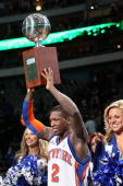 Nate Robinson of the New York Knicks celebrates his third win with the Champions Trophy after the Sprite Slam Dunk Contest on AllStar Saturday Night...