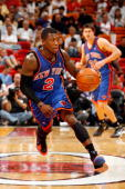 Nate Robinson of the New York Knicks drives against the Miami Heat during the game on October 28 2009 at American Airlines Arena in Miami Florida The...