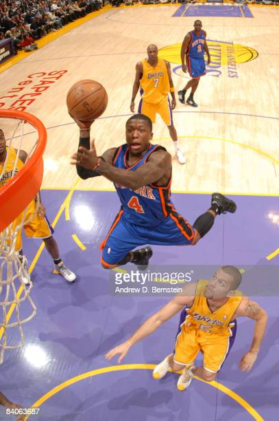 Nate Robinson of the New York Knicks goes up for a shot while Jordan Farmar of the Los Angeles Lakers looks on at Staples Center on December 16 2008...