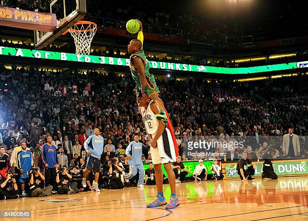 Nate Robinson of the New York Knicks leaps over Dwight Howard of the Orlando Magic in the finals of the Sprite Slam Dunk Contest on AllStar Saturday...