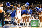 Nate Robinson of the New York Knicks reacts after a dunk during the Sprite Slam Dunk Contest on AllStar Saturday Night as part of 2010 NBA AllStar...