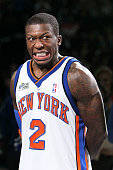 Nate Robinson of the New York Knicks reacts during the trophy presentation after his third win during the Sprite Slam Dunk Contest on AllStar...