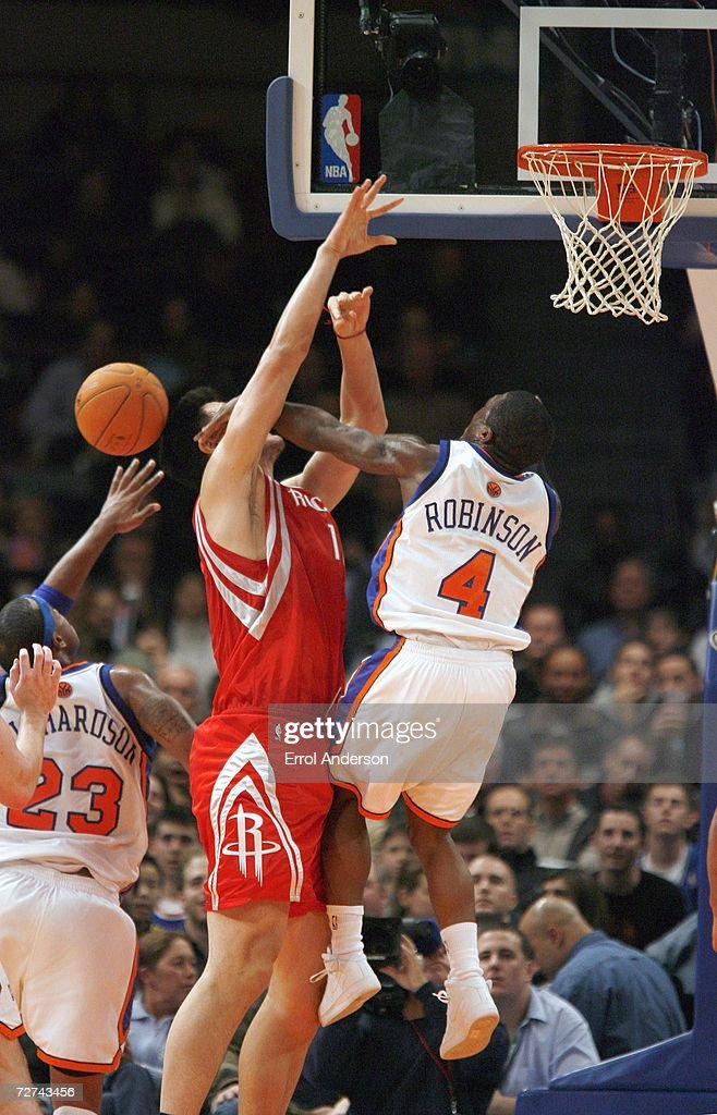 Nate Robinson #4 of the New York Knicks rejects the shot attempt of Yao Ming #11 of the Houston Rockets November 20, 2006 at Madison Square Garden in New York City.