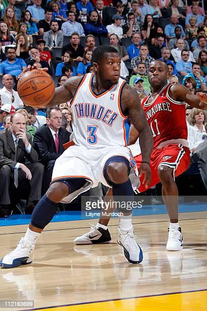 Nate Robinson of the Oklahoma City Thunder drives against Earl Boykins of the Milwaukee Bucks on April 13 2011 at the Oklahoma City Arena in Oklahoma...