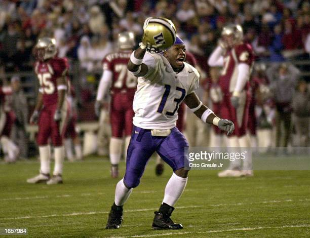 Nate Robinson of the Washington Huskies celebrates after they defeated the Washington State Cougars 2926 in triple overtime on November 23 2002 at...