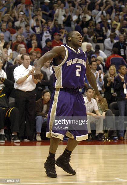 Nate Robinson of Washington celebrates 8172 victory over Arizona in the Pacific Life Pac10 Tournament Championship at the Staples Center in Los...