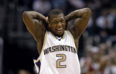 Nate Robinson of Washington grimaces after picking up his fourth foul during 6663 victory over Stanford in the Pacific Life Pac10 Tournament men's...