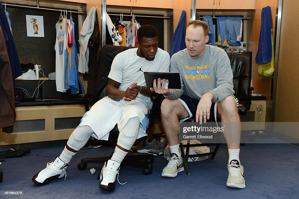 <a gi-track='captionPersonalityLinkClicked' href=/galleries/search?phrase=Nate+Robinson&family=editorial&specificpeople=208906 ng-click='$event.stopPropagation()'>Nate Robinson</a> #10 watches video with Assistant Coach Noel Gillespie of the Denver Nuggets on January 7, 2014 at the Pepsi Center in Denver, Colorado.