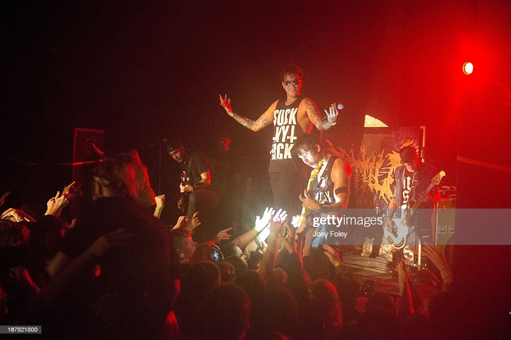 Nate Salameh, Chris 'Fronzilla' Fronzak, Chris Linck, and Kalan Blehm of the Metalcore band Attila performs in front of a sold out crowd at The Emerson Theater on October 27, 2013 in Indianapolis, Indiana.