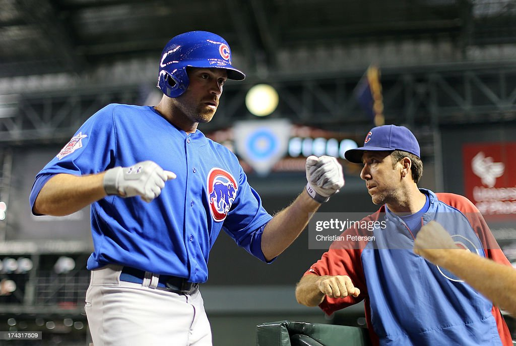 <a gi-track='captionPersonalityLinkClicked' href=/galleries/search?phrase=Nate+Schierholtz&family=editorial&specificpeople=803208 ng-click='$event.stopPropagation()'>Nate Schierholtz</a> #19 of the Chicago Cubs high fives teammates in the duogut after hitting a two run home against the Arizona Diamondbacks during the eighth inning of the MLB game at Chase Field on July 23, 2013 in Phoenix, Arizona.