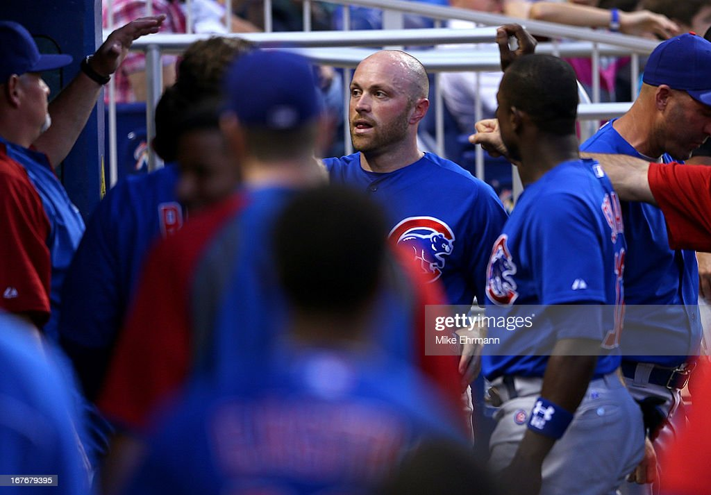 Nate Schierholtz #19 of the Chicago Cubs is congratulated after a home run during a game against the Miami Marlins at Marlins Park on April 27, 2013 in Miami, Florida.