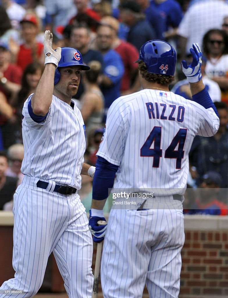 Nate Schierholtz #19 of the Chicago Cubs is greeted by teammate Anthony Rizzo #44 after hitting a home run against the Houston Astros during the fifth inning on June 22, 2013 at Wrigley Field in Chicago, Illinois.