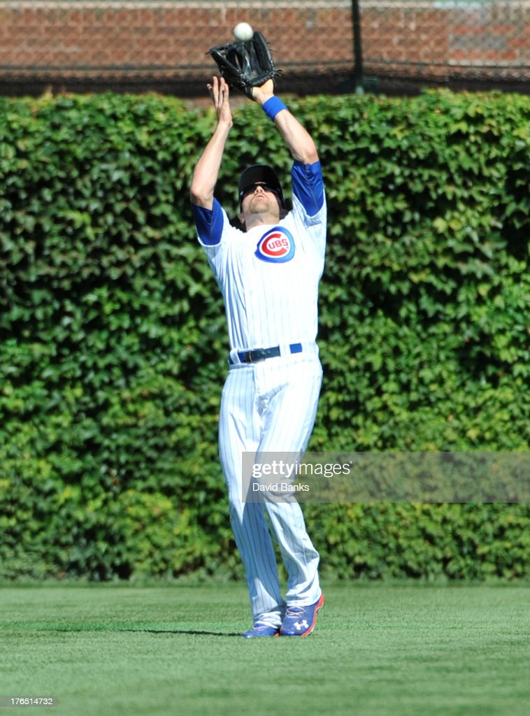 <a gi-track='captionPersonalityLinkClicked' href=/galleries/search?phrase=Nate+Schierholtz&family=editorial&specificpeople=803208 ng-click='$event.stopPropagation()'>Nate Schierholtz</a> #19 of the Chicago Cubs makes a catch on Jay Bruce #32 of the Cincinnati Reds during the eighth inning on August 14, 2013 at Wrigley Field in Chicago, Illinois.