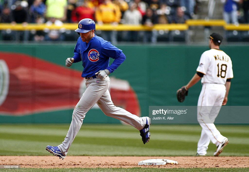 <a gi-track='captionPersonalityLinkClicked' href=/galleries/search?phrase=Nate+Schierholtz&family=editorial&specificpeople=803208 ng-click='$event.stopPropagation()'>Nate Schierholtz</a> #19 of the Chicago Cubs rounds second base after hitting a two run home run in the ninth inning against the Pittsburgh Pirates during the game on April 4, 2013 at PNC Park in Pittsburgh, Pennsylvania. The Cubs defeated the Pirates 3-2.