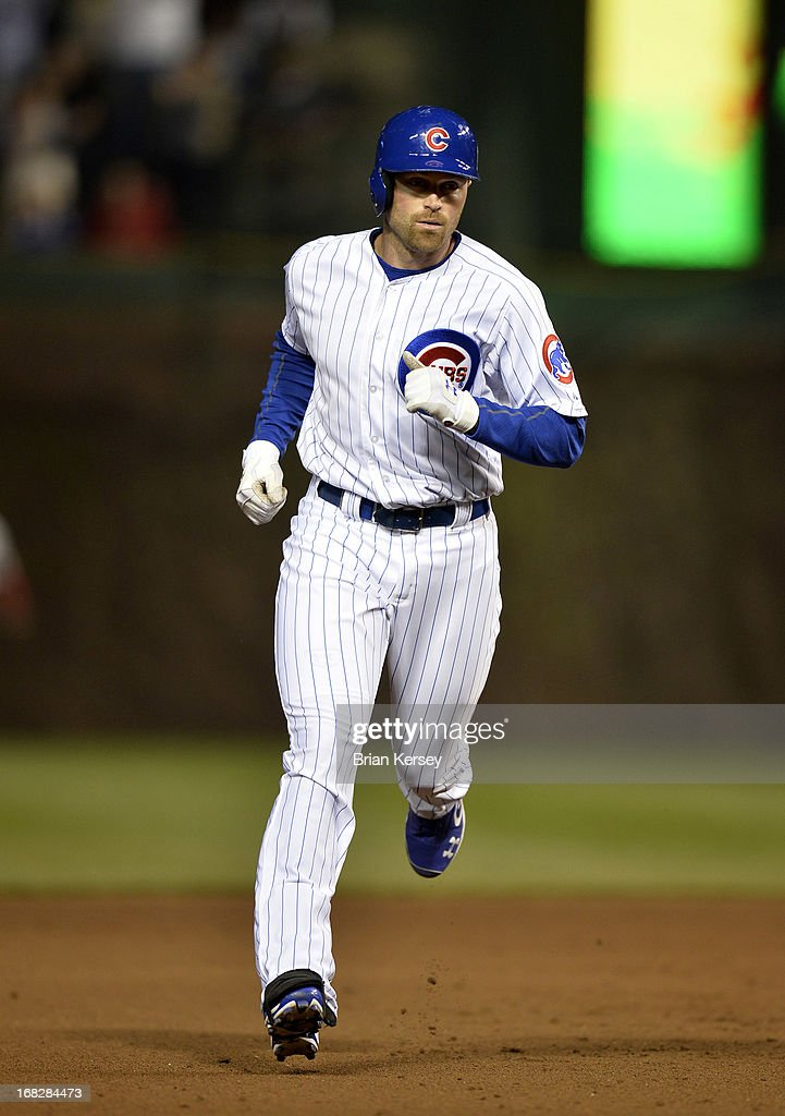 <a gi-track='captionPersonalityLinkClicked' href=/galleries/search?phrase=Nate+Schierholtz&family=editorial&specificpeople=803208 ng-click='$event.stopPropagation()'>Nate Schierholtz</a> #19 of the Chicago Cubs rounds the bases after hitting a two-run home run scoring Alfonso Soriano #12 during the fourth inning against the St. Louis Cardinals on May 7, 2013 at Wrigley Field in Chicago, Illinois.