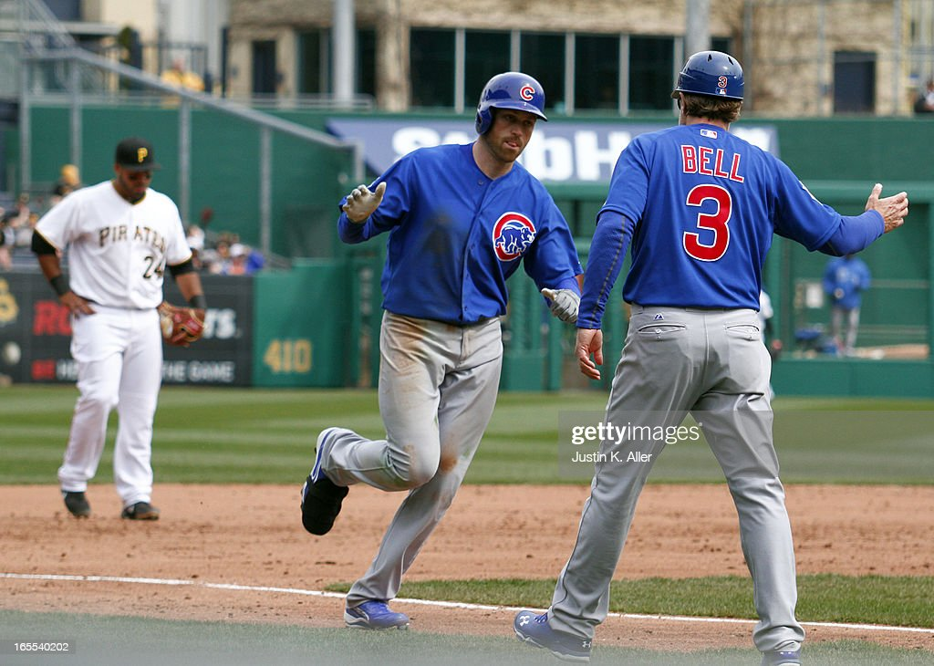<a gi-track='captionPersonalityLinkClicked' href=/galleries/search?phrase=Nate+Schierholtz&family=editorial&specificpeople=803208 ng-click='$event.stopPropagation()'>Nate Schierholtz</a> #19 of the Chicago Cubs rounds third base after hitting a two run home run in the ninth inning against the Pittsburgh Pirates during the game on April 4, 2013 at PNC Park in Pittsburgh, Pennsylvania. The Cubs defeated the Pirates 3-2.