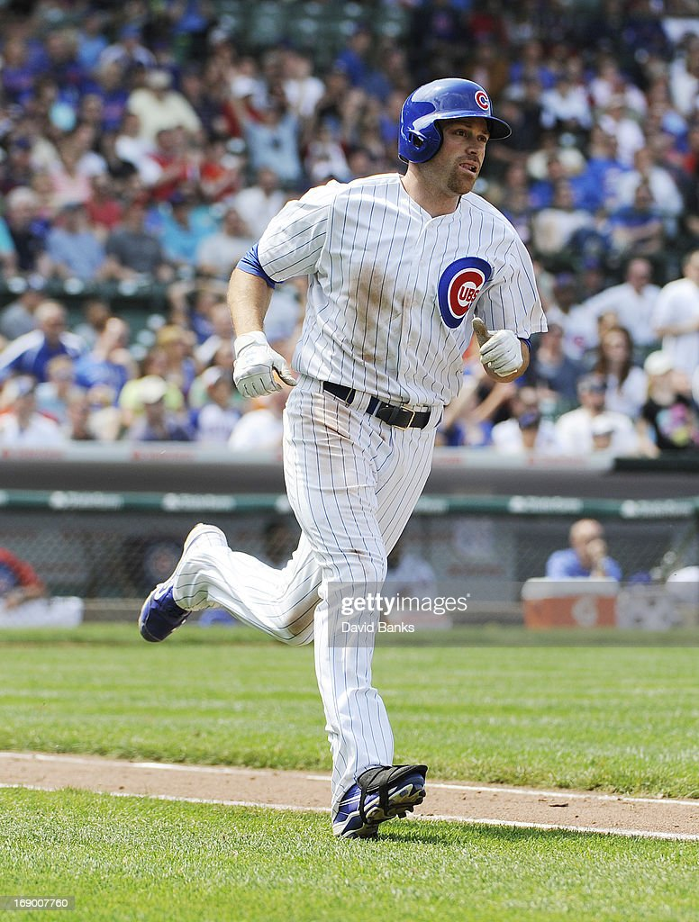 <a gi-track='captionPersonalityLinkClicked' href=/galleries/search?phrase=Nate+Schierholtz&family=editorial&specificpeople=803208 ng-click='$event.stopPropagation()'>Nate Schierholtz</a> #19 of the Chicago Cubs runs the base after hitting a home run during the eighth inning against the New York Mets on May 18, 2013 at Wrigley Field in Chicago, Illinois. The Chicago Cubs defeated New York Mets 8-2.