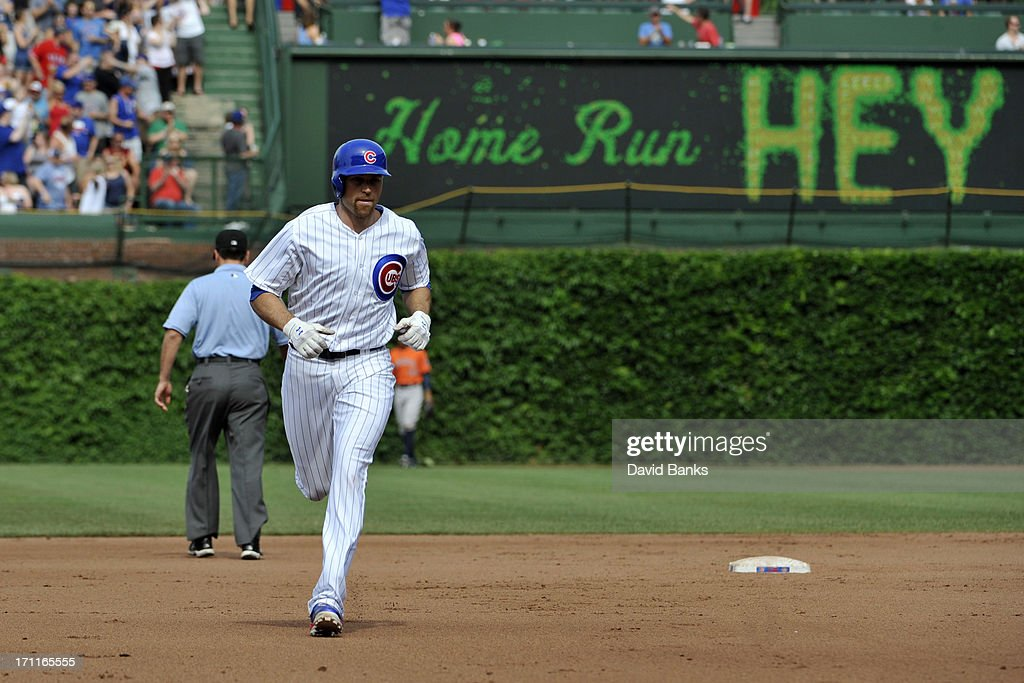 Nate Schierholtz #19 of the Chicago Cubs runs the bases after hitting a home run against the Houston Astros during the fifth inning on June 22, 2013 at Wrigley Field in Chicago, Illinois.