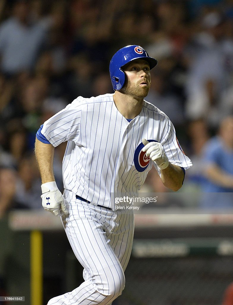 <a gi-track='captionPersonalityLinkClicked' href=/galleries/search?phrase=Nate+Schierholtz&family=editorial&specificpeople=803208 ng-click='$event.stopPropagation()'>Nate Schierholtz</a> #19 of the Chicago Cubs runs up the first base line after hitting a two-run home run scoring teammate Dioner Navarro #30 during the seventh inning against the Washington Nationals at Wrigley Field on August 19, 2013 in Chicago, Illinois.