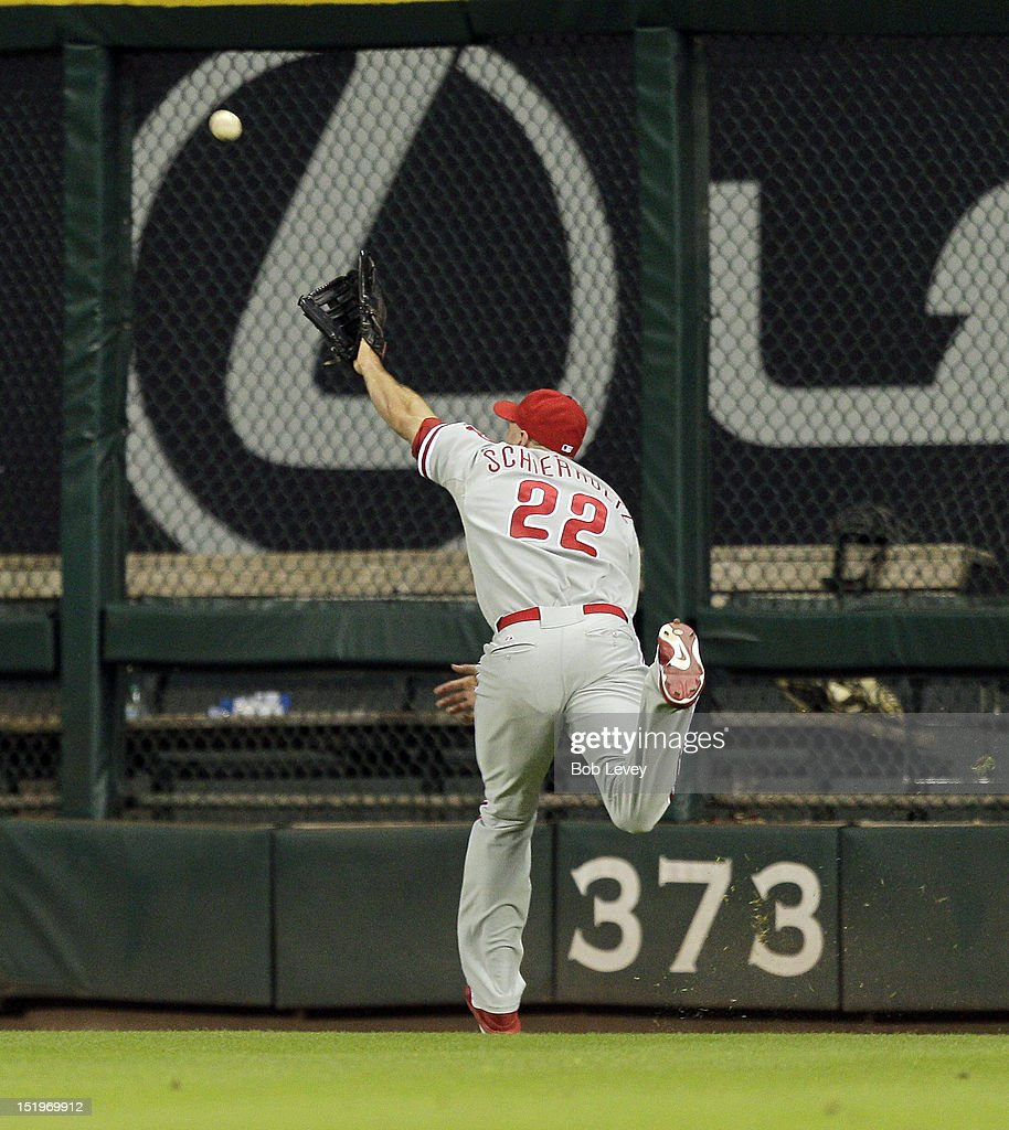 <a gi-track='captionPersonalityLinkClicked' href=/galleries/search?phrase=Nate+Schierholtz&family=editorial&specificpeople=803208 ng-click='$event.stopPropagation()'>Nate Schierholtz</a> #22 of the Philadelphia Phillies can't reach a ball off the bat of Jed Lowrie of the Houston Astros that went for a double in the eighth inning scoring two runs at Minute Maid Park on September 13, 2012 in Houston, Texas. Houston wins 6-4.