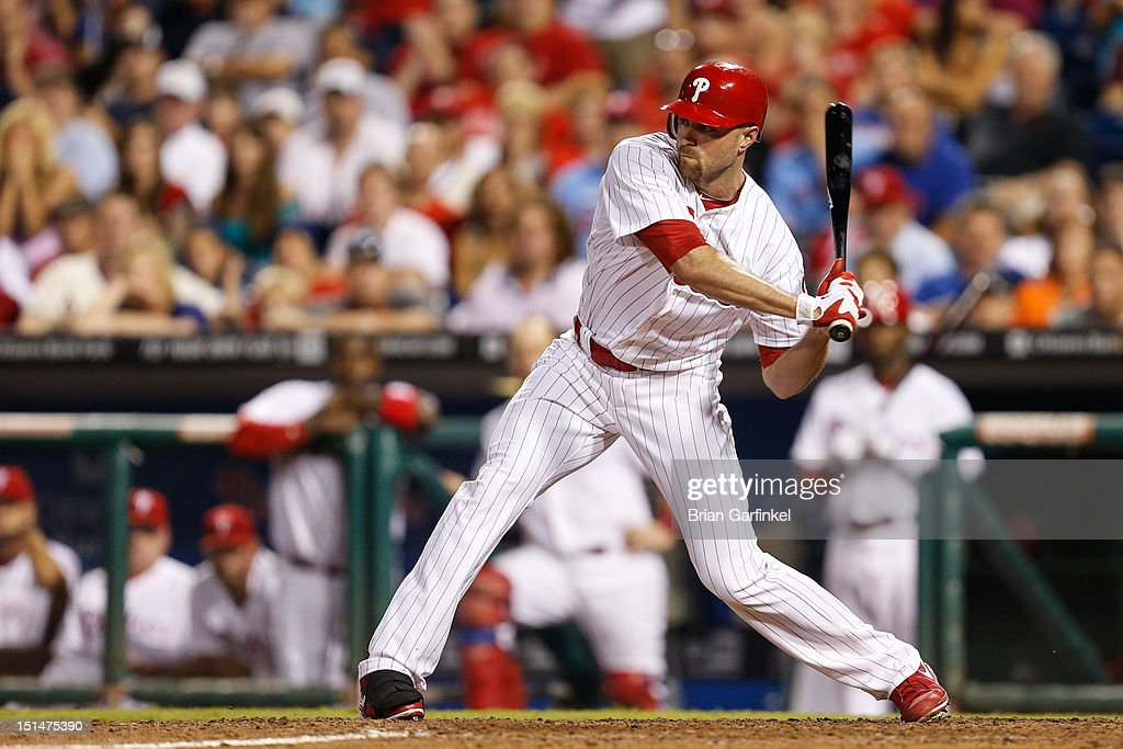 <a gi-track='captionPersonalityLinkClicked' href=/galleries/search?phrase=Nate+Schierholtz&family=editorial&specificpeople=803208 ng-click='$event.stopPropagation()'>Nate Schierholtz</a> #22 of the Philadelphia Phillies hits an RBI single to win the game against the Colorado Rockies at Citizens Bank Park on September 7, 2012 in Philadelphia, Pennsylvania. The Phillies won 3-2.