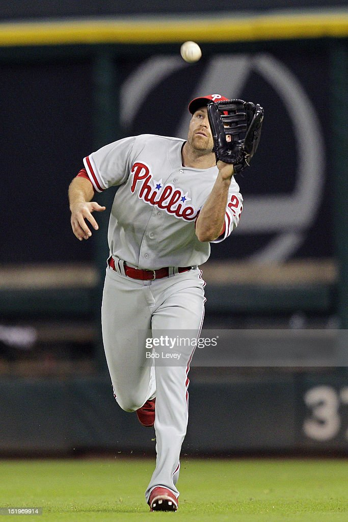 <a gi-track='captionPersonalityLinkClicked' href=/galleries/search?phrase=Nate+Schierholtz&family=editorial&specificpeople=803208 ng-click='$event.stopPropagation()'>Nate Schierholtz</a> #22 of the Philadelphia Phillies makes a catch on fly ball off the bat of Justin Maxwell of the Houston Astros in the eighth inning at Minute Maid Park on September 13, 2012 in Houston, Texas. Houston wins 6-4.
