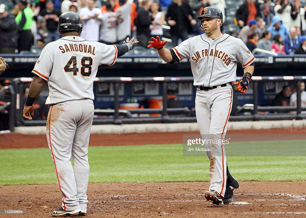 <a gi-track='captionPersonalityLinkClicked' href=/galleries/search?phrase=Nate+Schierholtz&family=editorial&specificpeople=803208 ng-click='$event.stopPropagation()'>Nate Schierholtz</a> #12 of the San Francisco Giants celebrates his third inning three-run home run against the New York Mets with teammate <a gi-track='captionPersonalityLinkClicked' href=/galleries/search?phrase=Pablo+Sandoval&family=editorial&specificpeople=803207 ng-click='$event.stopPropagation()'>Pablo Sandoval</a> #48 at Citi Field on April 23, 2012 in the Flushing neighborhood of the Queens borough of New York City.