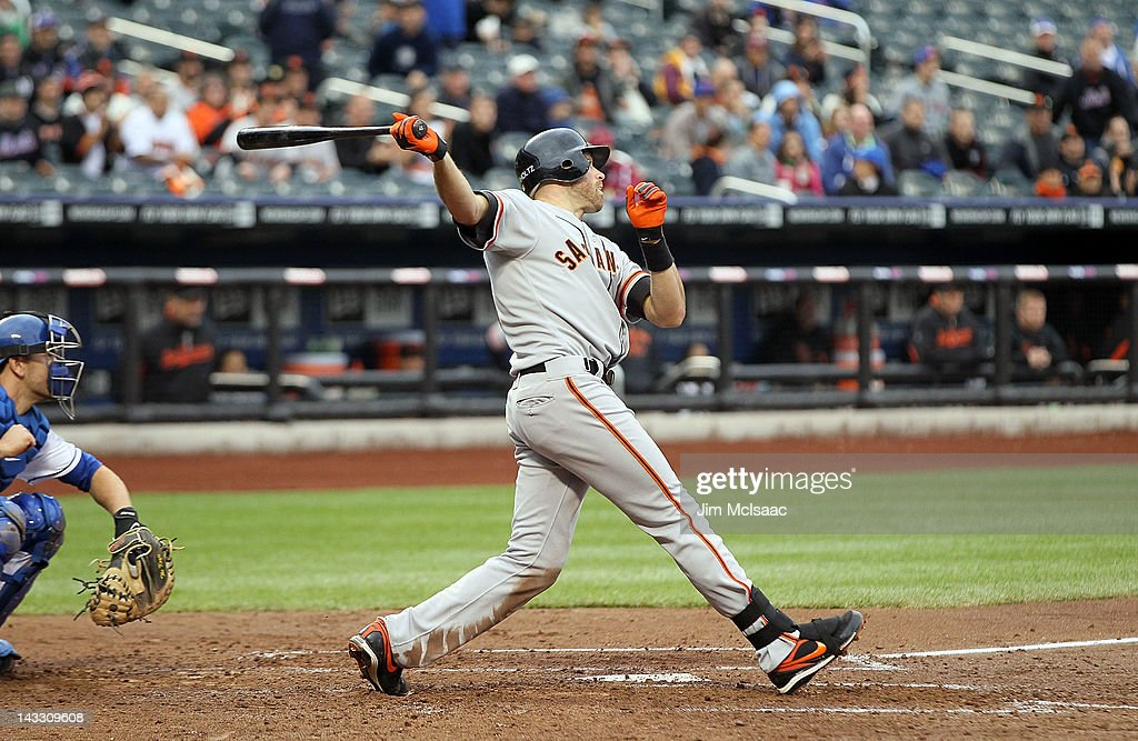 <a gi-track='captionPersonalityLinkClicked' href=/galleries/search?phrase=Nate+Schierholtz&family=editorial&specificpeople=803208 ng-click='$event.stopPropagation()'>Nate Schierholtz</a> #12 of the San Francisco Giants follows through on a third inning three-run home run against the New York Mets at Citi Field on April 23, 2012 in the Flushing neighborhood of the Queens borough of New York City.