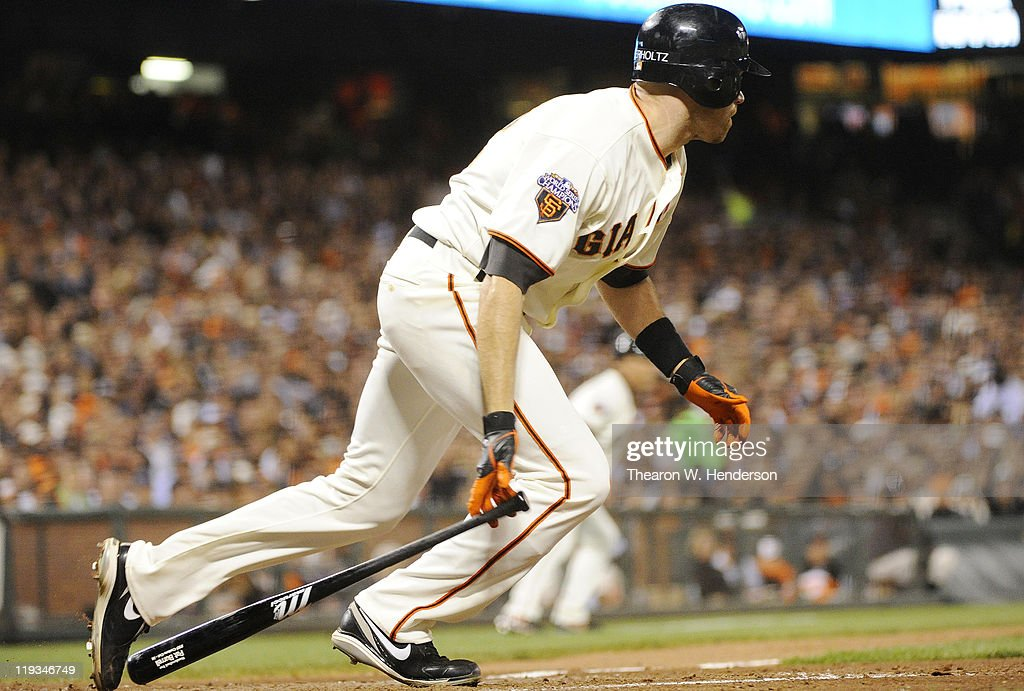 <a gi-track='captionPersonalityLinkClicked' href=/galleries/search?phrase=Nate+Schierholtz&family=editorial&specificpeople=803208 ng-click='$event.stopPropagation()'>Nate Schierholtz</a> #12 of the San Francisco Giants hits an RBI single, driving in Mike Fontenot against the Los Angeles Dodgers in the sixth inning during an MLB baseball game at AT&T Park July 18, 2011 in San Francisco, California.