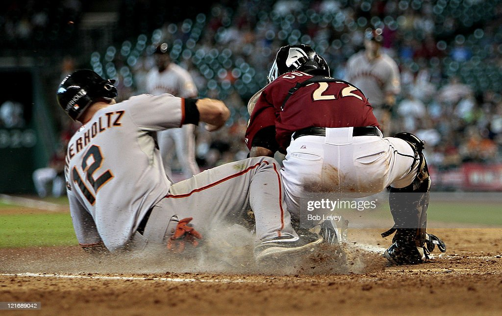 <a gi-track='captionPersonalityLinkClicked' href=/galleries/search?phrase=Nate+Schierholtz&family=editorial&specificpeople=803208 ng-click='$event.stopPropagation()'>Nate Schierholtz</a> #12 of the San Francisco Giants is tagged out at home plate by catcher Carlos Corporan #22 of the Houston Astros on a throw from left fielder J.D. Martinez in the eighth inning at Minute Maid Park on August 21, 2011 in Houston, Texas.