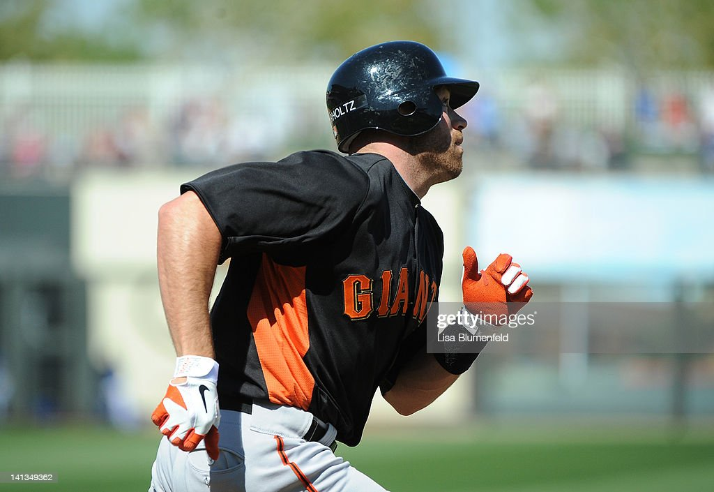 <a gi-track='captionPersonalityLinkClicked' href=/galleries/search?phrase=Nate+Schierholtz&family=editorial&specificpeople=803208 ng-click='$event.stopPropagation()'>Nate Schierholtz</a> #12 of the San Francisco Giants runs to first base during the preseason game against the Kansas City Royals on March 12, 2012 in Surprise, Arizona.
