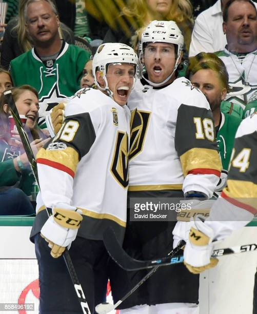 Nate Schmidt and James Neal of the Vegas Golden Knights react after Neal scored a goal against the Dallas Stars during the season opening game at...