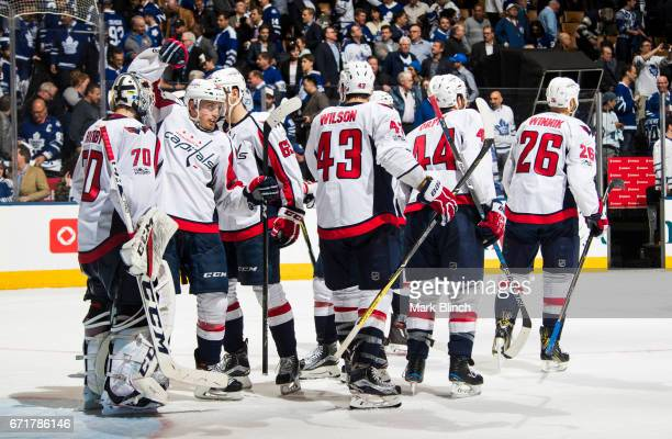 Nate Schmidt congratulates Braden Holtby of the Washington Capitals after they defeated the Toronto Maple Leafs during the third period in Game Four...